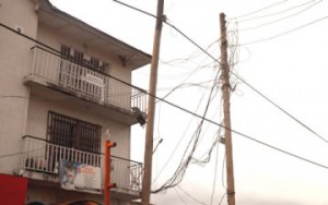 Electricity cables arkwardly connected to a building at Opebi, Ikeja... recently.